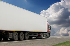 The truck on asphalt road. Container on the big highway. transport loads Stock Photos
