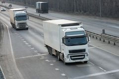 The truck on asphalt road. Container on the big highway. transport loads Stock Photo