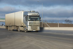 The truck on asphalt road. Container on the big highway. transport loads Royalty Free Stock Images