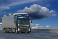 The truck on asphalt road. Container on the big highway. transport loads Royalty Free Stock Photos