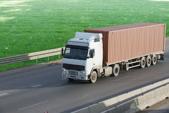 The truck on asphalt road. Container on the big highway. transport loads Stock Photography