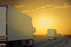 The truck on asphalt road. The truck driving towards sunset Royalty Free Stock Photography