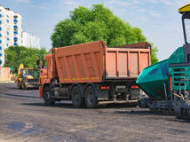 Truck asphalt for stowage. A truck brought hot asphalt for laying on a new road Royalty Free Stock Photo