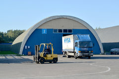 The truck and auto-loader in the territory of a modern warehouse Royalty Free Stock Photos