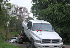 Truck being towed out of driveway royalty free stock photo