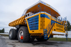 Truck BelAZ with man for scale Royalty Free Stock Photos