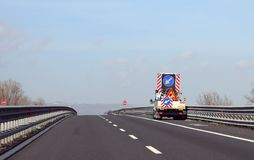 Truck with big road sign with arrow on the motorway. Before the roadworks royalty free stock image