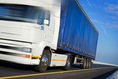 Truck with blue tent in motion Royalty Free Stock Photos