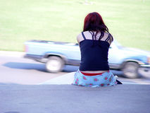 Truck Blur. And sitting girl Stock Images