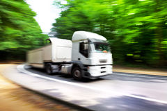 Truck in blurred motion on road. Blurred motion. Royalty Free Stock Image