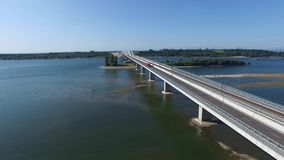 Truck on a bridge over Danube river. Connecting the Romanian city of Calafat and teh bulgarian city of Vidin stock footage