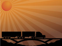 Truck on bridge passing in the sunset Stock Photos