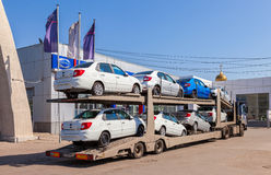 Truck brought new cars to car showroom Datsun in Samara, Russia Stock Photography
