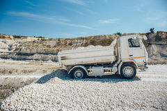Truck brought waste chalk quarry. Limestone mining Stock Photos