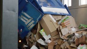 Truck brought the waste paper. To the garbage processing plant. Unloading of recyclable materials in the warehouse of the waste processing plant stock video footage