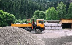 Truck with building materials in a forest in the open air