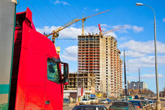 Truck cab red color on a background of construction Royalty Free Stock Photos
