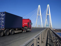 Truck on an cable-braced bridge. Cable-braced bridge and truck stock photography