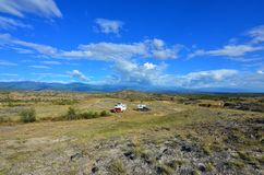 Truck campers set up near the Tatacoa desert, Colombia. Two overlanders find a spot to camp for the night in a field near the Tatacoa desert in Colombia stock photo