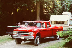 Truck and Camping Trailer. Red pickup truck with a camping trailer attached to the back stock image