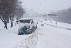 The trucks on the snowy road Stock Photos