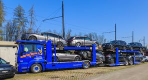 Truck with a car carrier trailer. Zurich, Switzerland - 28 March, 2017: a truck with a car carrier trailer standing on a parking lot. Car carrier trailers known Royalty Free Stock Photo