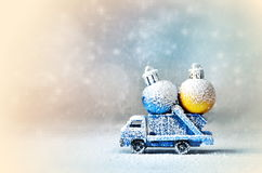 Truck car carries Cristmas ball for Christmas trees. Royalty Free Stock Images