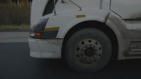 Wheels truck car moving on suburban road on asphalt background. Truck car moving on suburban road on asphalt background. Close up wheels truck with freight stock footage
