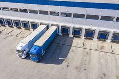 Truck on car parking near warehouse. Delivery and shipping concept. Aeria View. Drone. View royalty free stock photos
