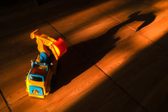 Truck car toy and its nightmare dark shadow Royalty Free Stock Images