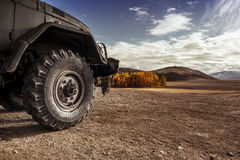 Truck car wheel offroad concept. Truck car wheel on offroad steppe adventure trail Stock Image