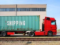 Truck with cargo container. On front of a factory Royalty Free Stock Photos