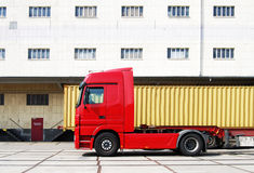 Truck and cargo container. In front of a factory Royalty Free Stock Photos
