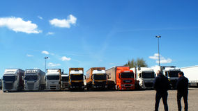 Truck Cargo on parking. Truck stop on Spain,with trucks aligned ,two drivers walk in direction of their machines.Sunshine and bluesky as background Stock Images