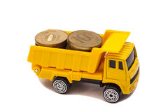 Truck caries and coins Royalty Free Stock Photography