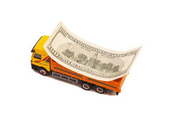 Truck caries  of one hundred dollar bill. Truck caries of one hundred dollar bill isolated on white background Royalty Free Stock Photo