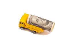 Truck caries a roll of one hundred dollar bill i Stock Photos