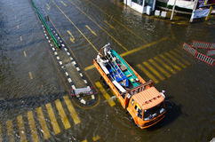 Truck carries a boat to help flood victims. BANGKOK THAILAND – NOVEMBER 13: Truck carries a group of people to evacuate from the flooded area at Phahon royalty free stock photo