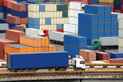 Truck carries container to warehouse near the sea Stock Photo