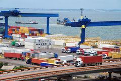 Truck carries container to warehouse near sea. Truck carries container to a warehouse near the sea Stock Images