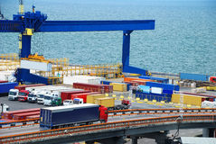 Truck carries container to warehouse near sea. Truck carries container to a warehouse near the sea Stock Photos