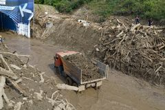 Truck carries debris after floods Stock Photography