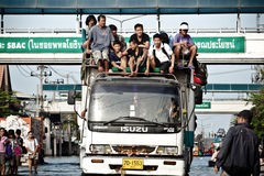 Truck carries a group of people to evacuate from t Stock Photography