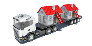 Truck carries two houses Stock Images