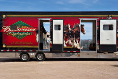 Truck carrying Budweiser Clydesdales. APACHE JUNCTION, AZ - FEBRUARY 26: Trucks carrying the Budweiser Clydesdale horses arrive at the Lost Dutchman Days rodeo royalty free stock images