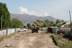 Truck carrying hay bales in Kyrgyzstan Royalty Free Stock Images