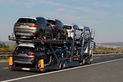 Truck carrying new cars Stock Images