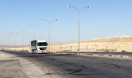 Truck circulating in a desert. Highway shobaken Jordan on a sunny day. It is an editorial image Stock Image