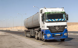 Truck circulating in a desert. Highway shobaken Jordan on a sunny day. It is an editorial image Royalty Free Stock Photo