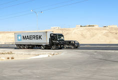Truck circulating in a desert Stock Image